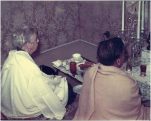 Sister Lalita and Swami Prabhavananda offer breakfast to Swami Vivekananda in the 1940s.